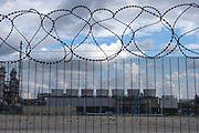 Strong security fence with additional razor wire protects the INEOS Seal Sands plant in Teesside, North East England, UK.  This industrial plant is one of the largest manufacturers of Acrylonitrile in Europe and is the largest producer of purified Acetonitrile in Europe.