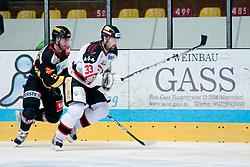 26.02.2013, Zimni stadion, Znojmo, CZE, EBEL, HC Orli Znojmo vs UPC Vienna Capitals, Playoff best of seven, 2. Runde, im Bild Peter Pucher (Znojmo #33) Markus Schlacher (Vienna #23) // during the Erste Bank Icehockey League playoff best of seven 2nd round match betweeen HC Orli Znojmo and UPC Vienna Capitals at the Zimni stadium, Znojmo, Czech Republic on 2013/02/26. EXPA Pictures © 2013, PhotoCredit: EXPA/ Rostislav Pfeffer.