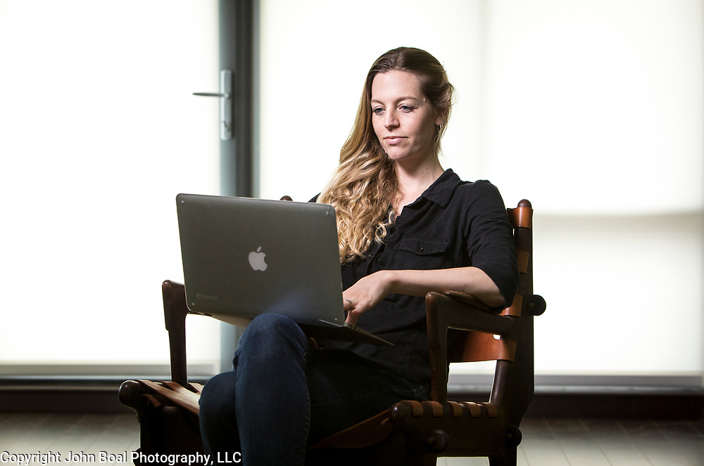 """Laurie Pickard, inside her Alexandria apartment, on Thursday, August 31, 2017. Pickard earned an M.B.A utilizing free online courses from a variety of prestigious universities. Furthermore, she started a website called nopaymba.com that is a resource for anyone seeking to do the same. Her book, called """"Don't Pay for Your M.B.A"""" will be published in October. CREDIT: John Boal for The Wall Street Journal"""