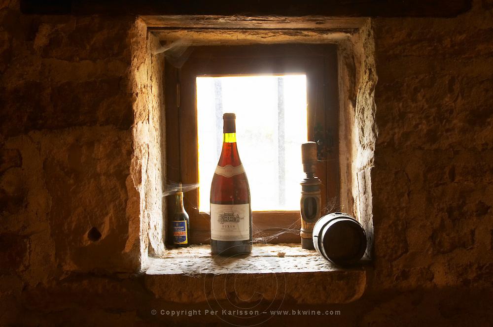old bottle in window in cellar clos st louis fixin cote de nuits burgundy france