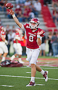 Arkansas quarterback Tyler Wilson (8) makes a pass before the start of an NCAA college football game against Auburn on Saturday, Oct. 8, 2011, in Fayetteville, Ark. (AP Photo/Beth Hall)