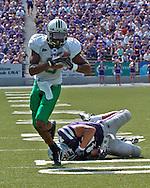 Marshall's James J.J. Johnson (8) brakes away for Kansas State's Brandon Archer (46) for a 18-yard blocked punt recovery touchdown in the second quarter, at Bill Snyder Family Stadium in Manhattan, Kansas, September 16, 2006.  The Wildcats beat the Thundering Herd 23-7.