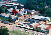 A Pitts Special biplane flies over the Main Street of Plains, Georgia - the hometown of President Jimmy Carter. - To license this image, click on the shopping cart below -