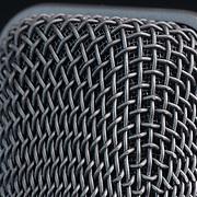 Closeup of the woven metal windscreen on a microphone head