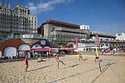 Male and female competitors play beach volleyball outside the Hilton Metropole along the Brighton seafront during Pride Festival on the 4th August 2018 in Brighton in the United Kingdom.