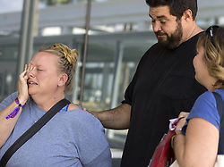 October 2, 2017 - Long Beach, CA, USA - Ryan Hultner of Fountain Valley greets his tearful wife Katy at the Long Beach Airport after she arrives back from Las Vegas. She and her friend escaped serious physical injury when a shooter opened fire  at a Jason Aldean concert, killing at least 58 people. (Credit Image: © Mindy Schauer/Press Enterprise via ZUMA Wire)
