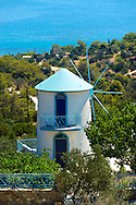 Windmill near Portes, Aegina, Greek Saronic Islands .<br /> <br /> If you prefer to buy from our ALAMY PHOTO LIBRARY  Collection visit : https://www.alamy.com/portfolio/paul-williams-funkystock/aegina-greece.html <br /> <br /> Visit our GREECE PHOTO COLLECTIONS for more photos to download or buy as wall art prints https://funkystock.photoshelter.com/gallery-collection/Pictures-Images-of-Greece-Photos-of-Greek-Historic-Landmark-Sites/C0000w6e8OkknEb8