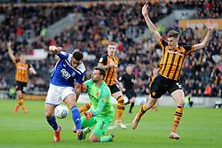 Birmingham City's Che Adams (left) beats Hull City goalkeeper David Marshall but misses the target