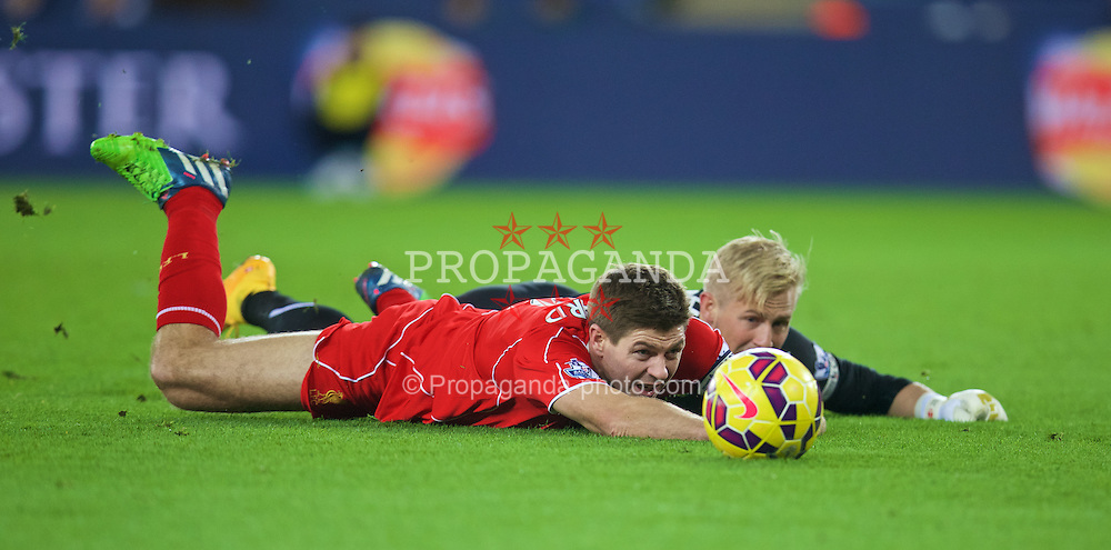 LEICESTER, ENGLAND - Tuesday, December 2, 2014: Liverpool's captain Steven Gerrard is brought down by Leicester City's goalkeeper Kasper Schmeichel but no penalty was awarded during the Premier League match at Filbert Way. (Pic by David Rawcliffe/Propaganda)
