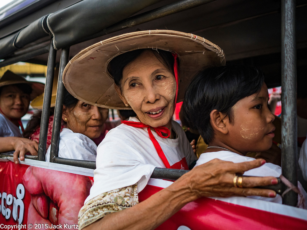 06 NOVEMBER 2015 - YANGON, MYANMAR:  A Burmese woman in a pickup truck watches the final NDF election rally of the 2015 election. The rally was held in central Yangon, next to the historic Sule Pagoda and across the street from Yangon city hall. The National Democratic Force (NDF) was formed by former members of the National League for Democracy (NLD) who chose to contest the 2010 general election in Myanmar because the NLD boycotted that election. There have been mass defections from the NFD this year because many of the people who joined the NFD in 2010 have gone back to the NLD, which is contesting this year's election and widely expected to win it. Campaigning in the Myanmar election ended Friday. People go to the polls Sunday.    PHOTO BY JACK KURTZ