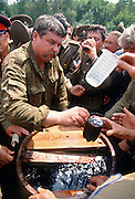 Russian Don Cossacks gather around a barrel of Kvass during the annual Cossack Festival in Novocherkassk, Russia. Kvass is a mildly alcoholic beverage made from fermented rye bread.