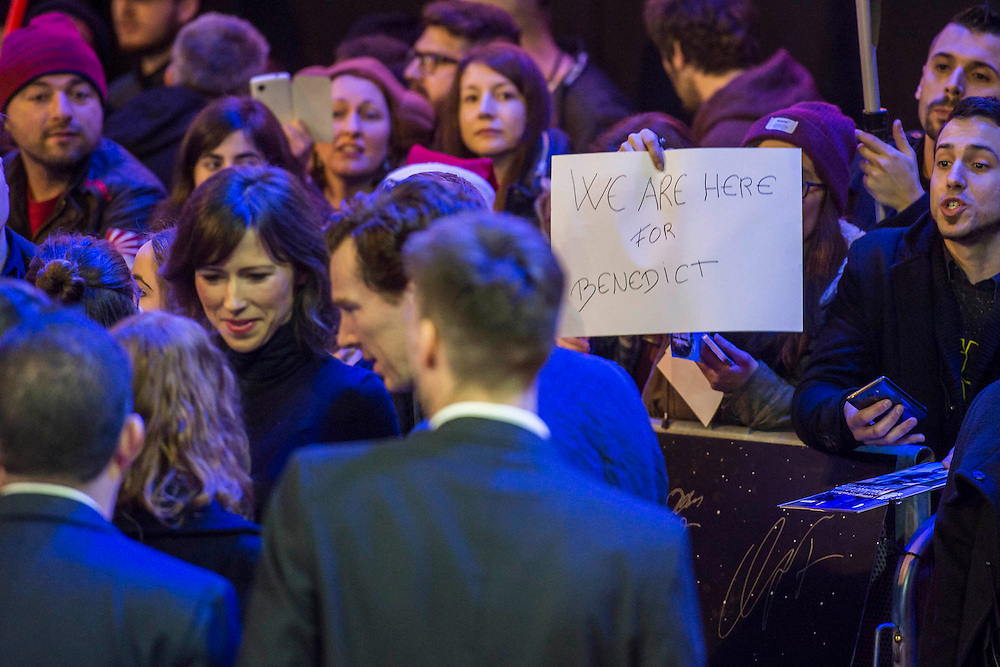 Benedict Cumberbatch ignores a sign form a fan - The European Premiere of STAR WARS: THE FORCE AWAKENS - Odeon, Empire and Vue Cinemas, Leicester Square, London.