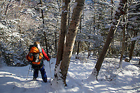 A boy hiking in the snow.