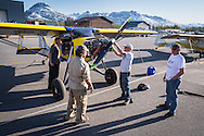 Steve Henry of Wild West Aircraft talks to airshow attendees by his Just Aircraft SuperStol. Valdez fly-in & Air Show in Valdez, Alaska. May 10 and 11, 2014. Photos by Scott Dickerson.