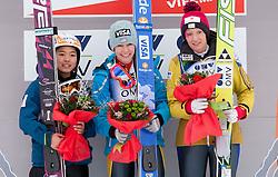 Second placed Sara Takanashi of Japan, winner Sarah Hendrickson of USA and third placed Daniela Iraschko of Austria at medal ceremony during Normal Hill Individual Competition at FIS World Cup Ski jumping Ladies Ljubno 2012, on February 11, 2012 in Ljubno ob Savinji, Slovenia. (Photo By Vid Ponikvar / Sportida.com)