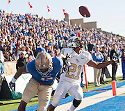 Nov 17, 2012; Tulsa, OK, USA; University of Central Florida Knights defensive back A.J. Bouye (21) breaks up a pass intended for Tulsa Hurricanes wide receiver Jordan James (12) during a game at Skelly Field at H.A. Chapman Stadium. Tulsa defeated UCF 23-21. Mandatory Credit: Beth Hall-US PRESSWIRE