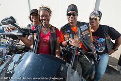 Denise Lasalle Travis (2nd from left) with three sisters of the Harley's Angels MC in Atlanta rode from the East Coast for the Lone Star Rally. Galveston, TX. USA. Saturday November 4, 2017. Photography ©2017 Michael Lichter.