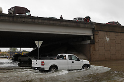 (170827) -- HOUSTON, Aug. 27, 2017 (Xinhua) -- People and cars are stuck on the highway as most of the major highways are closed due to heavy rain and flood in great Houston area, Texas, the United States, Aug. 27, 2017. Widespread and worsening flood conditions prompted the closure of nearly every major road in Houston as the outer bands of Hurricane Harvey swept through the Houston area over the weekend. Latest news reports said the storm death toll has climbed to at least 5. (Xinhua/Song Qiong) (Photo by Xinhua/Sipa USA)