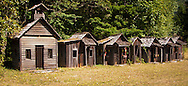 Tiny rustic cabins in a line are a tourist attraction in Ashford, WA, USA panorama