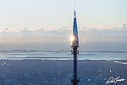 Aerial view of the finial or spire of One World Trade Center, photographed at sunrise from a helicopter.