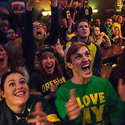 Students and community members of Eugene cheer for the ducks during the 2015 BCS National Championship against Ohio State. Oregon would go on to lose the game.