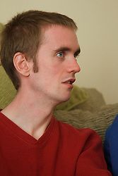 Young man with autism on sofa. Cleared for Mental Health issues.