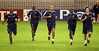 Photograph: Scott Heavey.<br />Chelsea training session in Prague before the Champions League match. 15/09/2003.<br />Juan Sebastian Veron (centre) strides ahead during training.