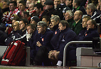 Photo: Paul Thomas.<br /> Liverpool v Arsenal. Carling Cup. 09/01/2007.<br /> <br /> Arsene Wenger, manager of Arsenal watches from the bench.