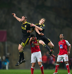 BRAGA, PORTUGAL, Thursday, March 10, 2011: Liverpool's Andy Carroll and Lucas Leiva challenge for the same ball muscling out Sporting Clube de Braga's Hugo Viana during the UEFA Europa League Round of 16 1st leg match at the Estadio Municipal de Braga. (Photo by David Rawcliffe/Propaganda)