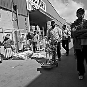 CEUTA, SPAIN - JUNE 27, 2010 : Activity  of carriers seeking  to transport goods at the warehouses located around the pedestrian cross border of  Biutz. Thousands  of people are involved in transporting smuggled goods from Ceuta (an Spanish enclave on the North African coast) to Morocco, it is estimated that every day enter 10.000 porters, mostly women, that it make between three and five trips to Morocco with all types of products purchased on  the warehouse border area of  Biutz in Ceuta, Spain .( Photo by Jordi Cami )