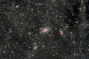 The area around the bright galaxies Messier 81 and Messier 82 in constellation Ursa Major showing faint nebulosity (integrated flux) lying beyond the galaxies.