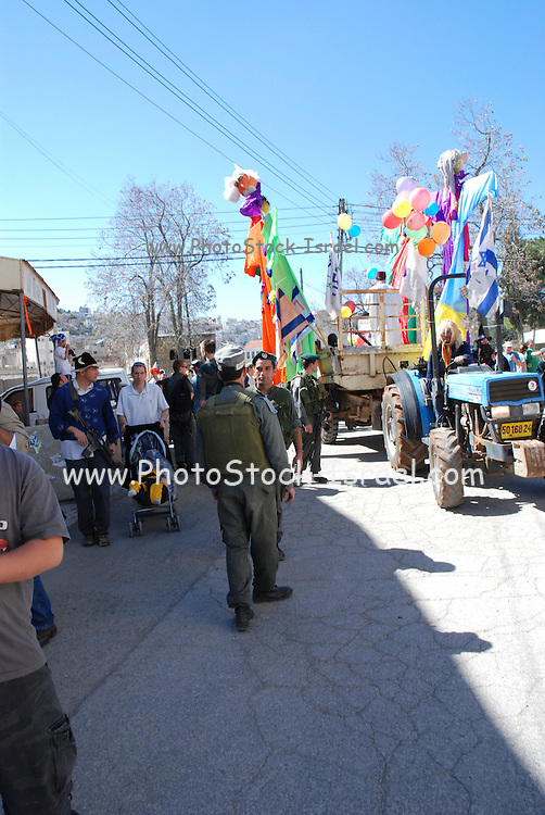 Israel, Palestine, West Bank, Hebron, Jewish Settlers celebrate Purim protected by Israeli security forces March 2007