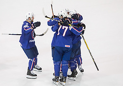 Damien Fleury of France and other players of France celebrate after winning during the 2017 IIHF Men's World Championship group B Ice hockey match between National Teams of France and Belarus, on May 12, 2017 in AccorHotels Arena in Paris, France. Photo by Vid Ponikvar / Sportida