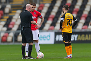 Today's referee Kevin Johnstone with the two Captains before the start of the The FA Cup match between Newport County and Salford City at Rodney Parade, Newport, Wales on 28 November 2020.