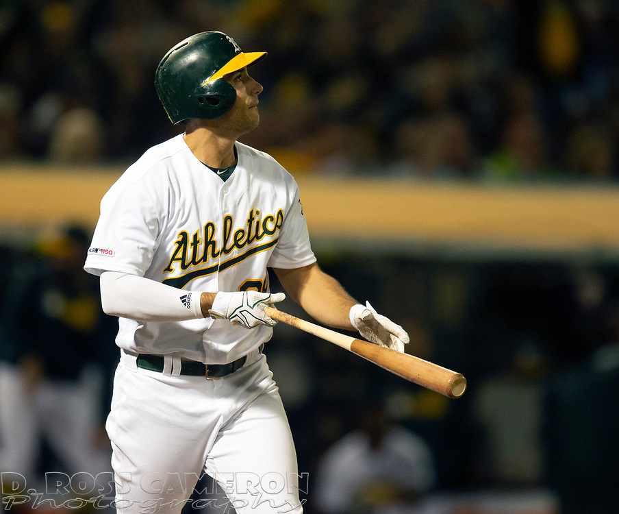 Sep 17, 2019; Oakland, CA, USA; Oakland Athletics Matt Olson (28) follows the flight of his solo home run off Kansas City Royals starting pitcher Jorge Lopez during the seventh inning of a baseball game at Oakland Coliseum. Mandatory Credit: D. Ross Cameron-USA TODAY Sports