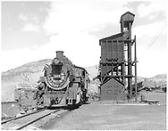 """D&RGW #497 passing over the Durango ash pit.  Notice the clinker tool rack nearby.<br /> D&RGW  Durango, CO  Taken by Richardson, Robert W.<br /> In book """"Durango: Always a Railroad Town (1st ed.)"""" page 51"""