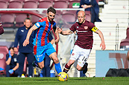 Sean Walsh (#4) of Inverness Caledonian Thistle FC and Steven Naismith (#14) of Heart of Midlothian FC during the SPFL Championship match between Heart of Midlothian and Inverness CT at Tynecastle Park, Edinburgh Scotland on 24 April 2021.