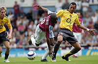 Photo: Paul Thomas.<br /> West Ham United v Arsenal. The Barclays Premiership. 24/09/2005.<br /> <br /> West Ham's Nigel Reo-Coker gets tackled by Gilberto.