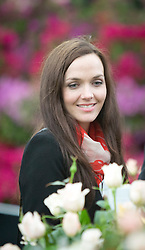 © Licensed to London News Pictures.19/05/2013. Olympic cyclist Victoria Pendleton admires a rose garden at the  100th RHS Chelsea Flower Show gets underway.  Photo credit: Alison Baskerville/LNP