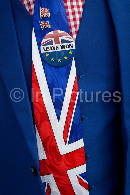 As MPs decide on how to progress with Brexit parliamentary procedure, a Leaver Brexiteers Union Jack tie and badge outside the UK Parliament in Westminster, on 28th March 2019, in London, England.