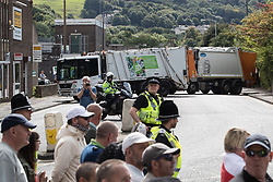 © Licensed to London News Pictures . 02/09/2017 . Keighley , UK . Bin lorries are used to block roads through the town centre for the EDL march . Far-right street protest movement , the English Defence League ( EDL ) , hold a demonstration in the West Yorkshire town of Keighley , opposed by anti-fascists , including Unite Against Fascism ( UAF ) . The EDL say they are demonstrating against the sexual grooming and abuse of English girls by Muslim men and against terrorism across the UK . Photo credit : Joel Goodman/LNP