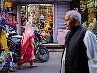 JODHPUR, INDIA - CIRCA NOVEMBER 2018: People in the streets of Jodphur selling vegetables. Jodhpur is the second largest city in the Indian state of Rajasthan. Jodhpur is a popular tourist destination, featuring many palaces, forts and temples, set in the stark landscape of the Thar Desert. It is popularly known as Blue city and Sun city among people of Rajasthan and all over India