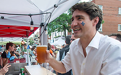 Prime Minister Justin Trudeau buys a beer at a street party for the Fete National du Quebec, Saturday, June 24, 2017 in Montreal, Canada. Photo by Paul Chiasson/CP/ABACAPRESS.COM