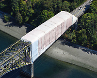 Containment system installed at the Bainbridge Island end of the Agate Pass Bridge along SR 305, for the maintenance and painting of the steel truss cantilever bridge constructed in 1950.