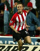 Photograph: Scott Heavey.<br />Southampton v Charlton Athletic. FA Barclaycard Premiership. 07/12/2003.<br />Brett Ormerod celebrates the winner for the Saints