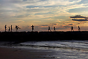People silhouetted on the jetty at Sesuit Harbor in Dennis, MA. I feel this moment really captures the magic of a summer evening on Cape Cod.