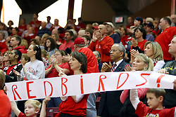 07 February 2009: Mr. Redbird - Illinois State University President Al Bowman sits behind several young fans holding a hand-made REDBIRD sign. Illinois State increased their 1st place lead by beating 2nd place Indiana State by a score of 69-48. The Illinois State University Redbirds hosted the Indiana State University Sycamores on Doug Collins Court inside Redbird Arena on the campus of Illinois State University in Normal Illinois