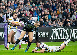 Cory Allen of Ospreys evades the tackle of Dean Hammond of Worcester Warriors<br /> <br /> Photographer Simon King/Replay Images<br /> <br /> European Rugby Challenge Cup Round 5 - Ospreys v Worcester Warriors - Saturday 12th January 2019 - Liberty Stadium - Swansea<br /> <br /> World Copyright © Replay Images . All rights reserved. info@replayimages.co.uk - http://replayimages.co.uk