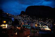 Lights from densely-built houses of Rocinha favela dot the valley in Rio de Janeiro, Brazil.