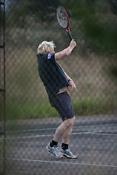 NOTE TO EDITORS: Images captured from a public footpath that passes close to the garden of Mr Johnson © Licensed to London News Pictures. 10/09/2018. Thame, UK. Boris Johnson plays tennis with his sister Rachel Johnson in the garden of his Oxfordshire house. Last week it was announced that Boris Johnson and his wife Marina Wheeler are getting divorced. Photo credit: Peter Macdiarmid/LNP